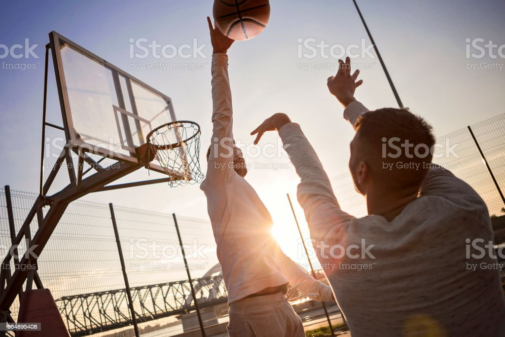 Basketball player playing outdoors royalty-free stock photo