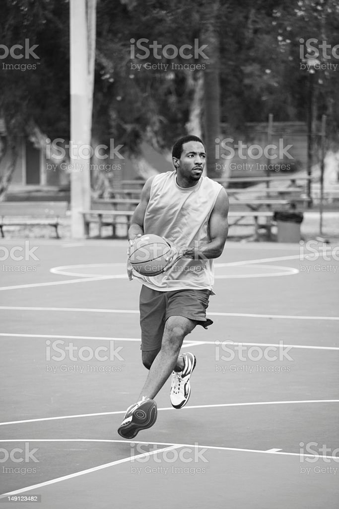 Basketball player running with the ball stock photo