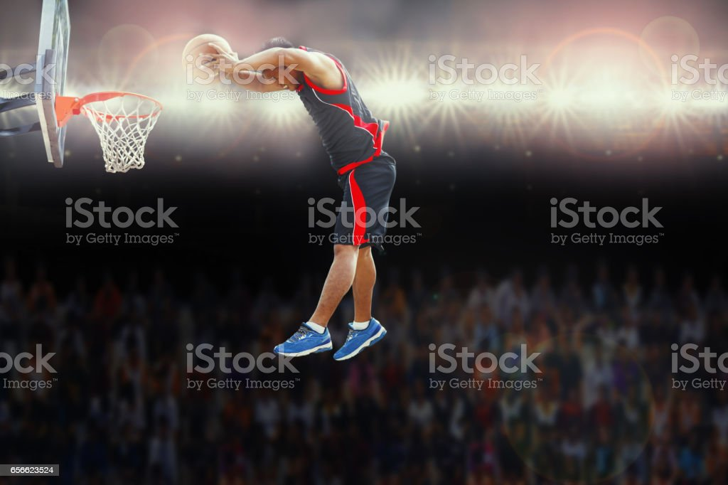 Basketball player scoring an athletic during match stock photo
