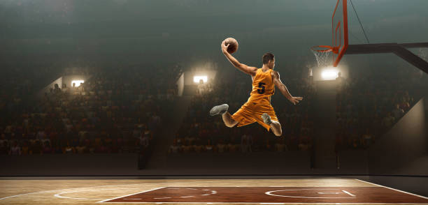 basketball player scoring. slam dunk - basket foto e immagini stock