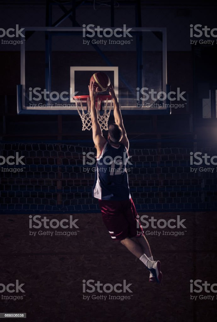 basketball player slam dunk, in air stock photo