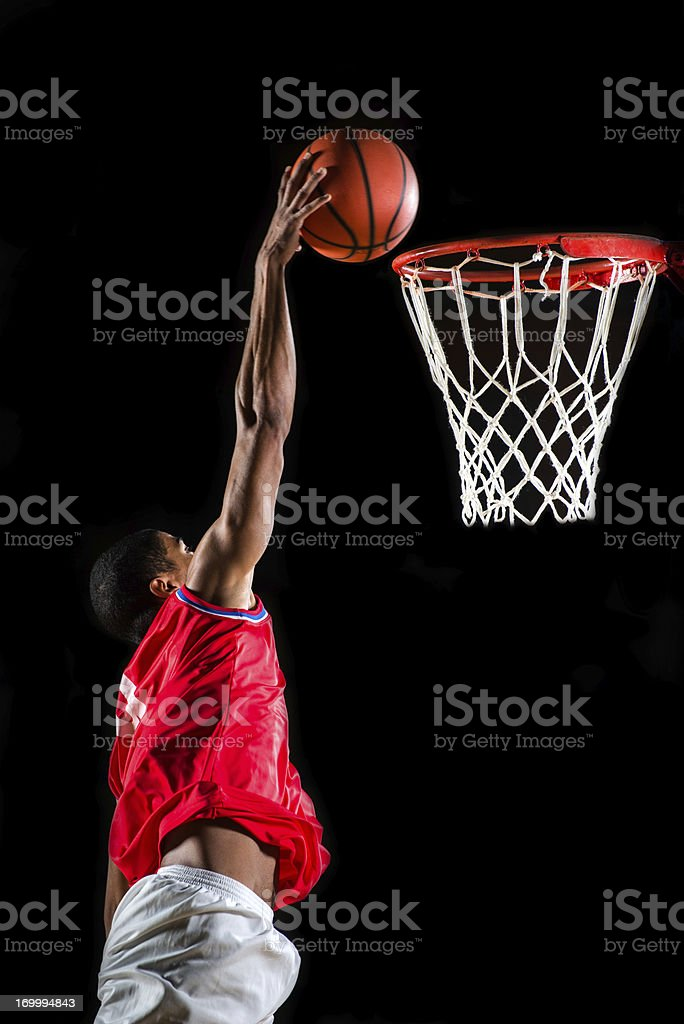 Basketball player slam dunking the ball. stock photo