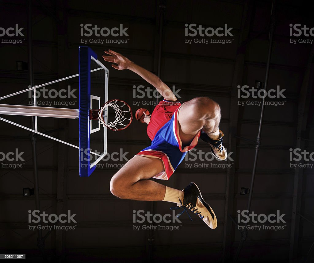 Basketball player slam dunking the ball. royalty-free stock photo