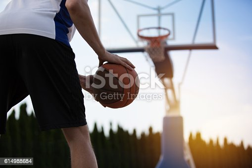 istock Basketball player training on the court. concept about basketbal 614988684