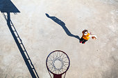 Basketball player under the basket. outdoor court
