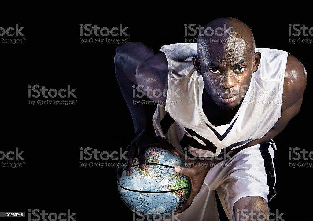 Basketball player with globe basketball stock photo