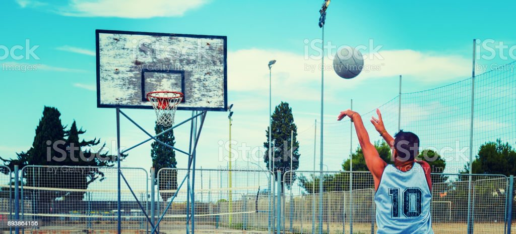 Basketball player workout in a playground stock photo