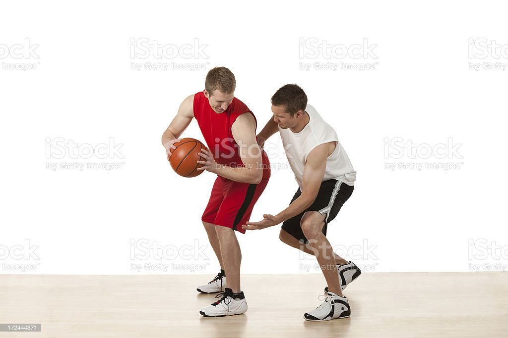 Basketball players in action royalty-free stock photo