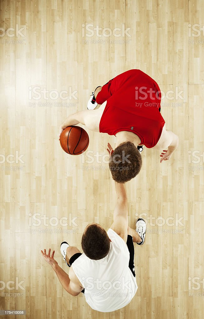 Basketball players in action stock photo