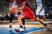 istock Basketball players tackling for ball 1253350295