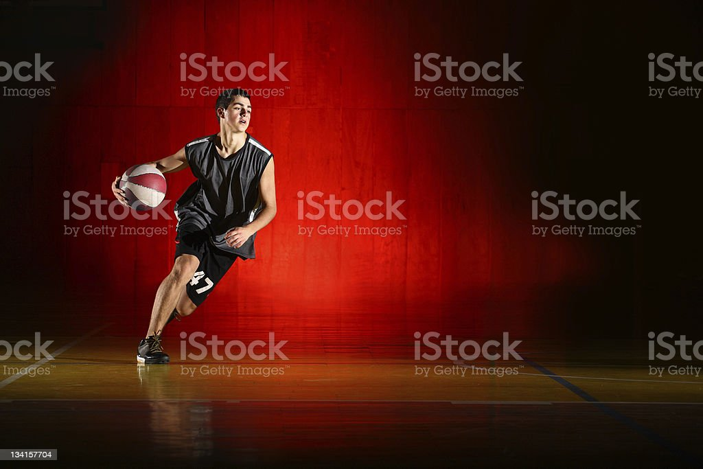 Basketball run on red background stock photo