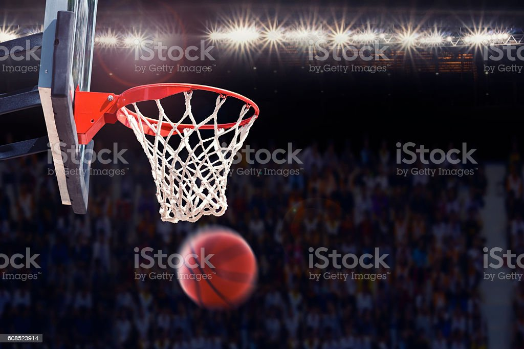 basketball scoring during match in arena stock photo