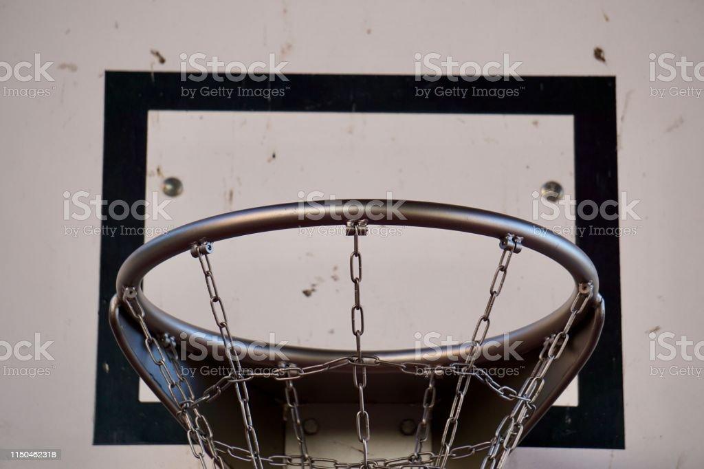 basketball sport hoop with metallic net in the street, old basket