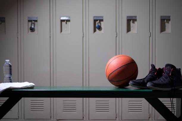 Basketball sports equipment in school gymnasium locker room. stock photo
