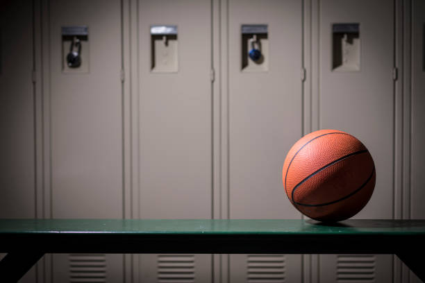 Basketball sports equipment in school gymnasium locker room. stock photo