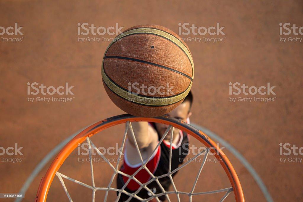 Basketball street player making a slam dunk stock photo