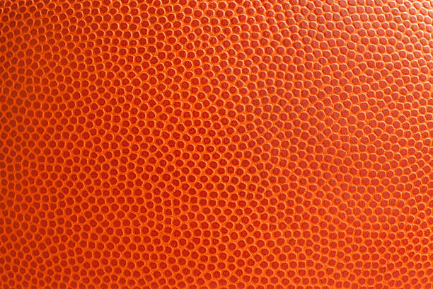 basketball texture close up - basketball ball stock photos and pictures