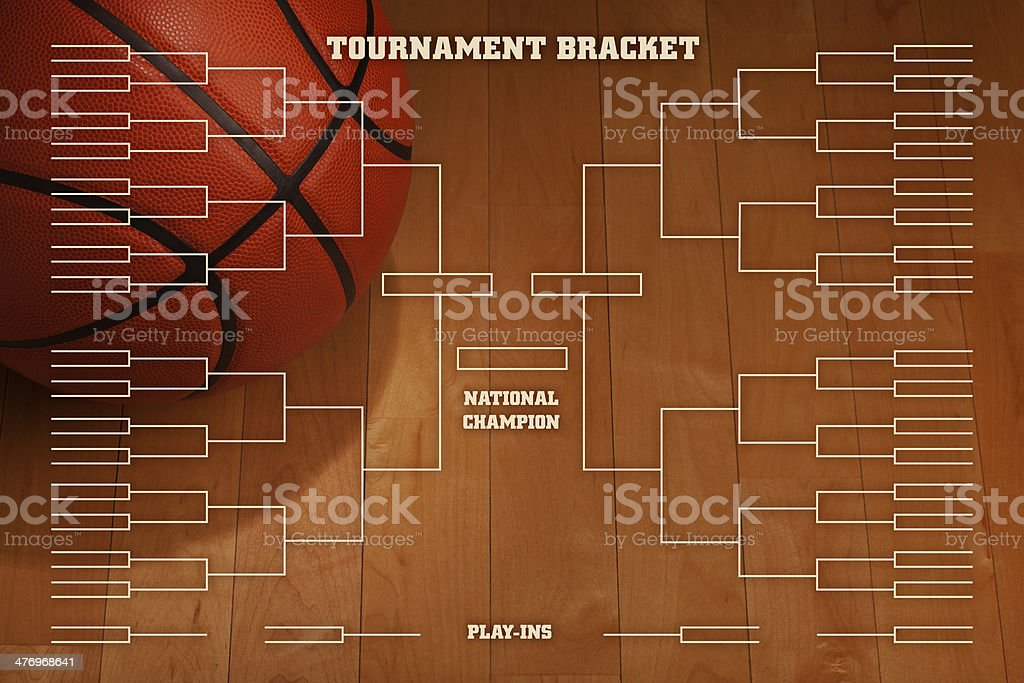 Basketball tournament bracket with spot lighting on wood gym floor stock photo