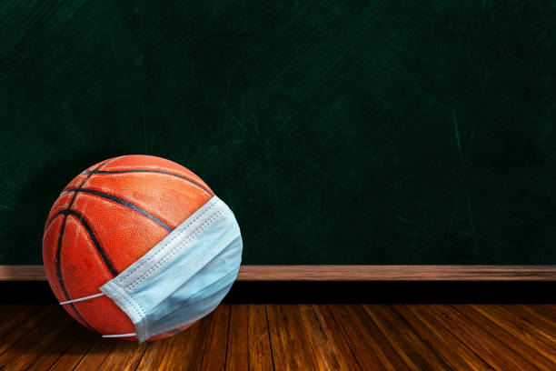 Basketball Wearing Mask With Chalkboard Background and Copy Space stock photo