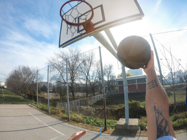 POV Basketballer taking a shot stock photo