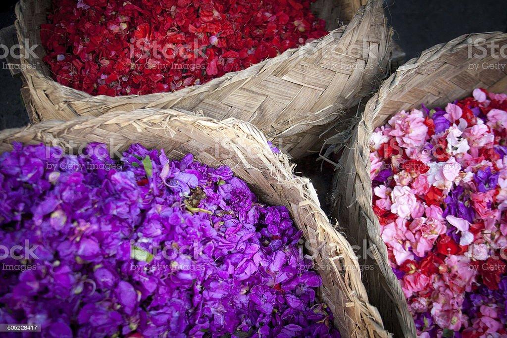 Baskets of Bright Flower Petals at Morning Market, Bali stock photo