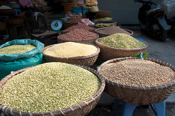 Baskets Of Dried Ground Food At A Street Market stock photo