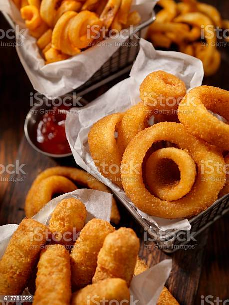 Baskets of onion rings curly fries and cheese sticks picture id617781022?b=1&k=6&m=617781022&s=612x612&h=damdntur5ts6 pqzzgwdrit1v8cr4tte7ovz9fl exu=