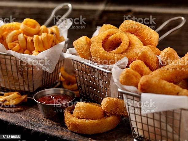 Baskets of onion rings curly fries and cheese sticks picture id621849666?b=1&k=6&m=621849666&s=612x612&h=bbtqhbr1qvoa08 byjky8osv4wp4sfix72caf1y2bxy=