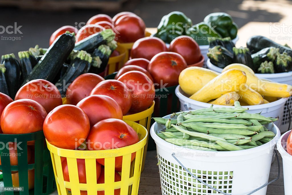 Baskets of Vegetables For Sale at Farmers Market stock photo