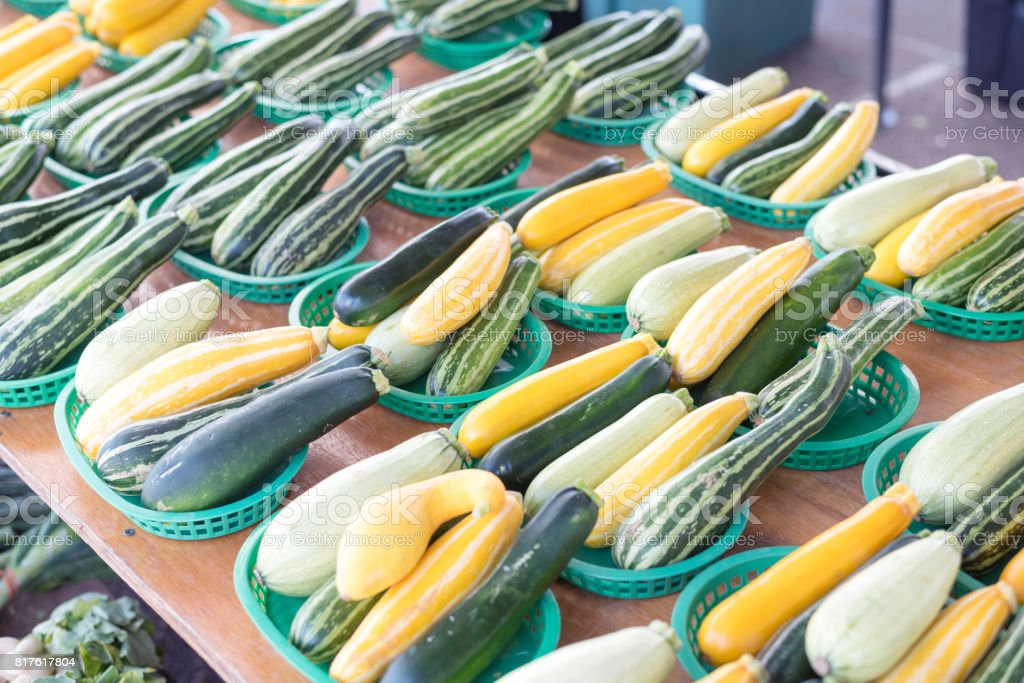 Baskets of zucchinis at farmers market stock photo