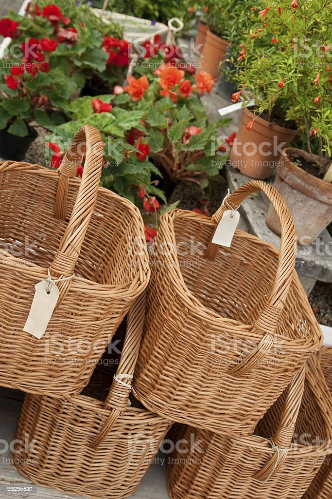 Baskets with blank labels in a flower shop royalty-free stock photo