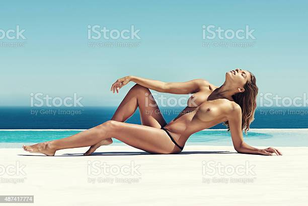 Shot of a gorgeous young woman sunbathing topless outdoorshttp://195.154.178.81/DATA/i_collage/pi/shoots/805382.jpg