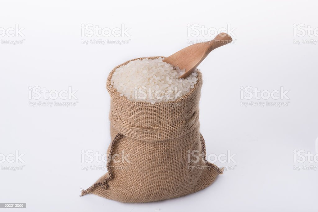 basmati rice in a wooden bowl isolated on white background stock photo