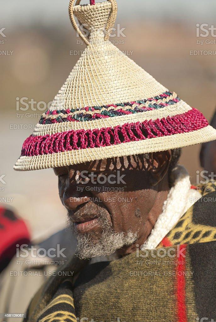 Basotho man watching the King's Parade stock photo