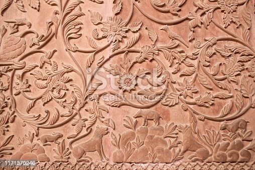 Ancient stone bas-relief with flowers and animals in Junagarh fort in Bikaner, Rajasthan, India