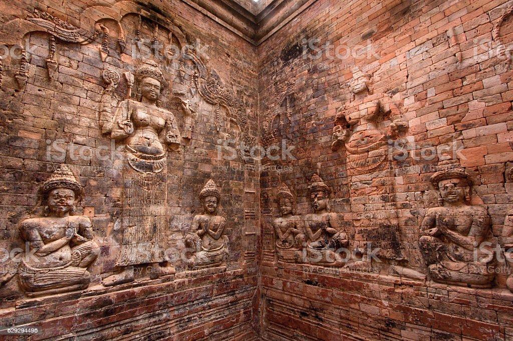 Bas-relief inside Prasat Kravan stock photo