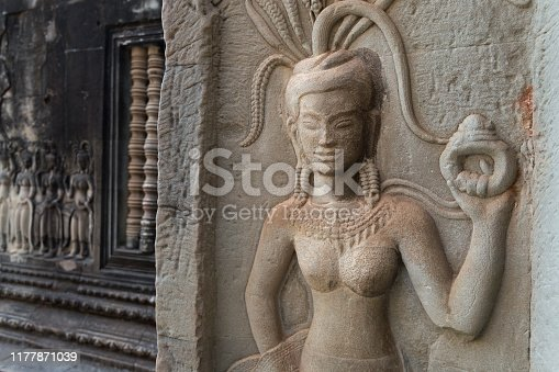 1147569123 istock photo Bas-relief mural of the woman Apsara on wall Angkor Wat temple complex, close up 1177871039