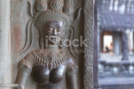 1147569123 istock photo Bas-relief mural of the woman Apsara on wall Angkor Wat temple complex, close up 1178268287