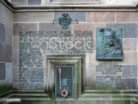 Slovakia, Kosice - May 2, 2018: Bas-relief of Francis II Rakoczi on the facade of the Saint Elizabeth Cathedral. Bronze plaque on the wall of an old church with a portrait of Ferenc II Rakoczi and inscriptions in Latin