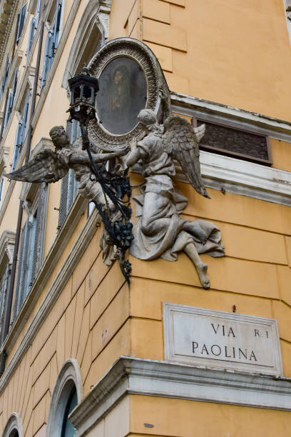 Bas-relief of the Virgin Mary at the crossroads of Via Liberian and Via Paolina in Rome stock photo
