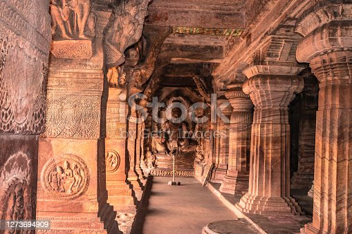 Bas-relief on the wall of the cave temple of Badami Vishnu sitting on Adi-Shesh image is taken at badami karnataka india. it is unesco heritage site and place of amazing chalukya dynasty sotne art.