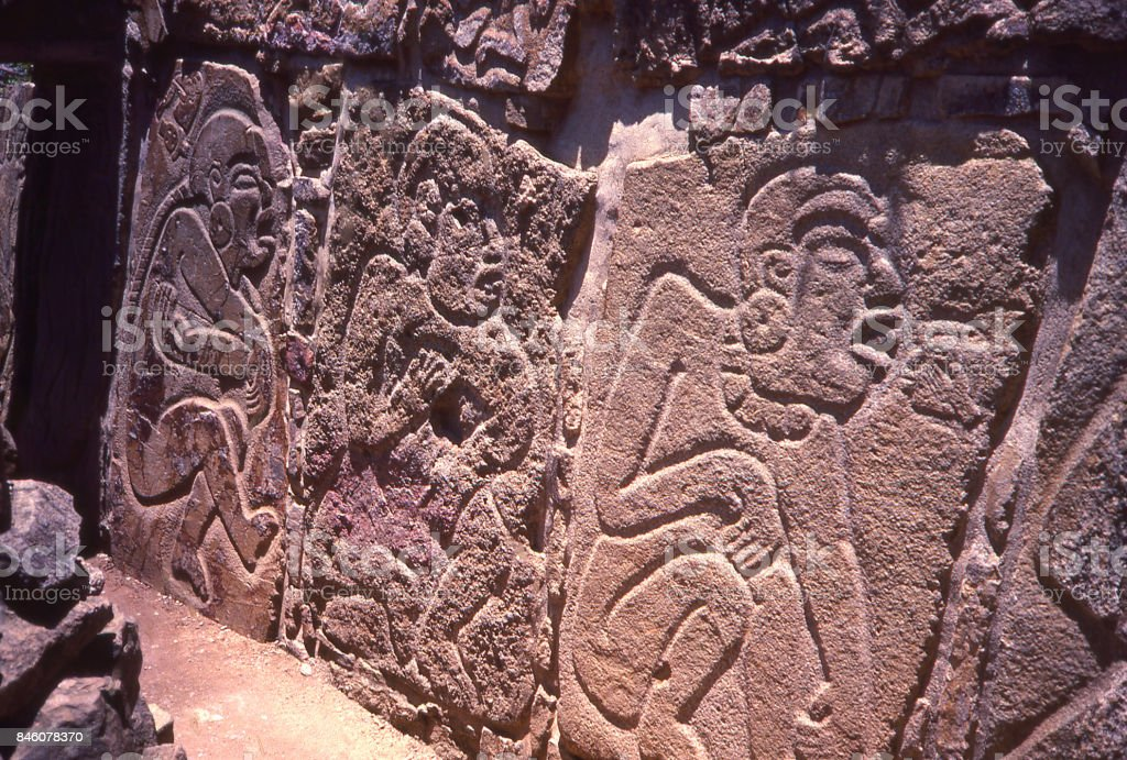 Bas-relief sculpture by Zapotec peoples at ruins of Monte Albán Oaxaca Mexico stock photo