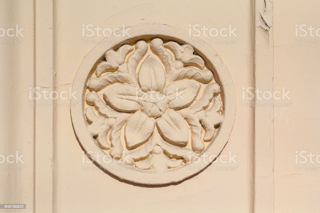 Bas-relief with a flower pattern on the wall. Architecture stock photo