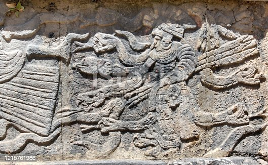 Bas-relief carving with indian warrior and serpent, pre-Columbian Maya civilization, Chichen Itza, Yucatan, Mexico. UNESCO world heritage site