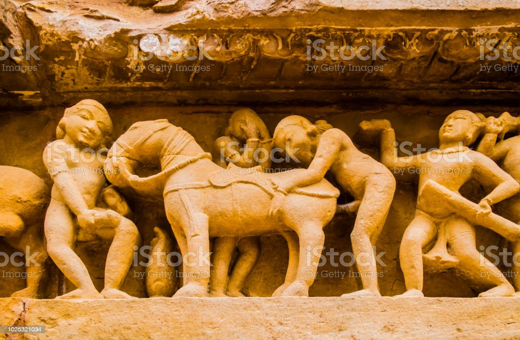 Bas-relief with stone carved erotic scenes in Kahjuraho temple, India stock photo