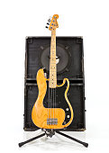 Los Angeles, California, USA - July 27, 2011:  Illustrative editorial photo of a vintage Fender Precision bass guitar with a two 15 inch speaker box.