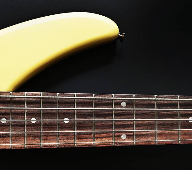 Bass guitar 5-string fretboard and section of body stock photo