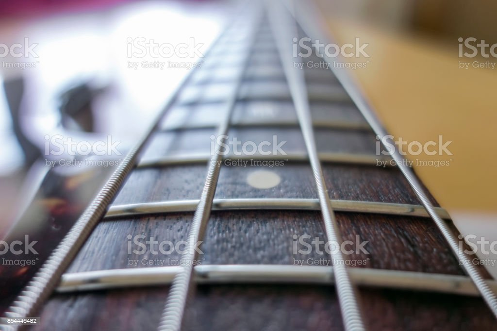 Bass guitar neck and strings stock photo