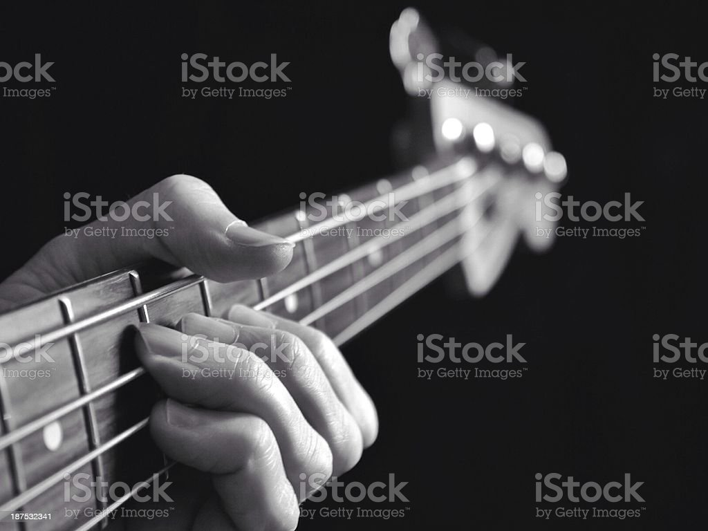 Bass Guitar On Black Background Lesson Stock Photo