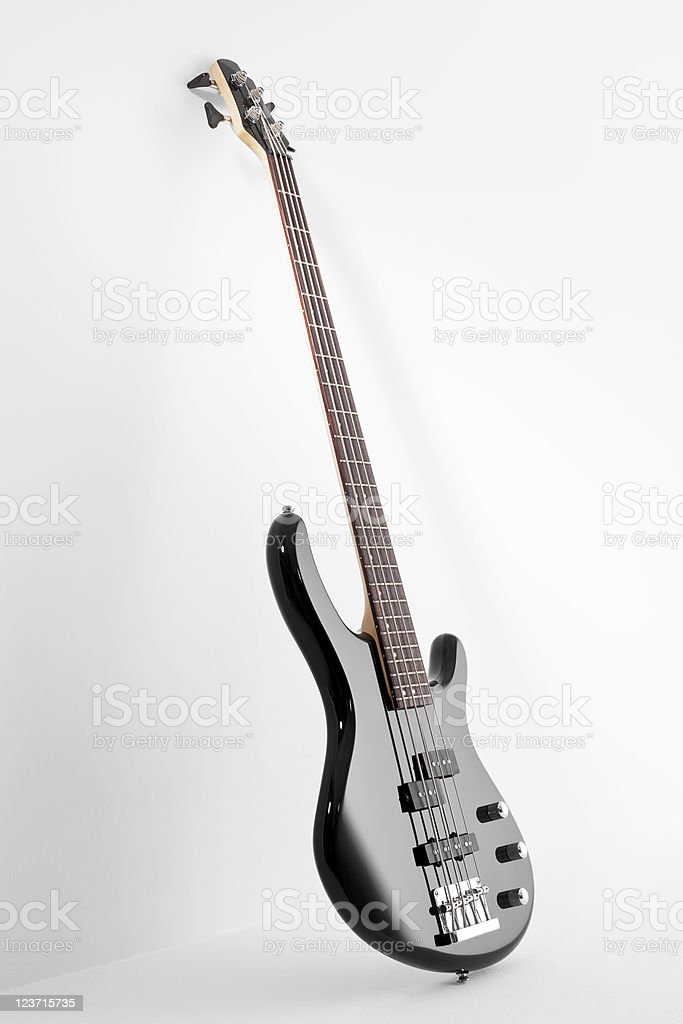 Bass guitar on white background stock photo